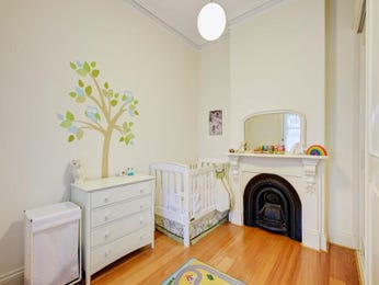 Children's room bedroom design idea with floorboards & fireplace using cream colours - Bedroom photo 524713