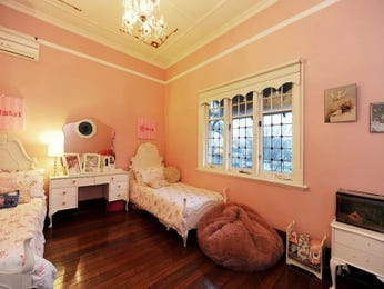 Children's room bedroom design idea with floorboards & sash windows using pink colours - Bedroom photo 524085