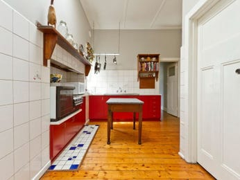 Retro l-shaped kitchen design using floorboards - Kitchen Photo 526957