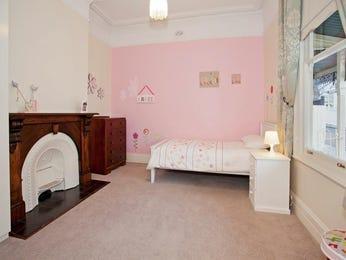 Children's room bedroom design idea with carpet & fireplace using cream colours - Bedroom photo 524761