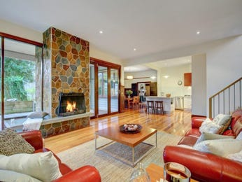 Orange living room idea from a real Australian home - Living Area photo 523389