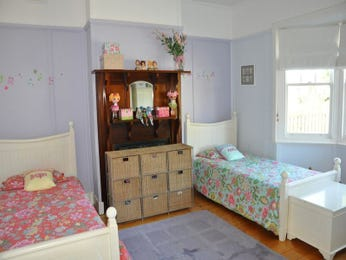 Children's room bedroom design idea with floorboards & fireplace using pastel colours - Bedroom photo 524117