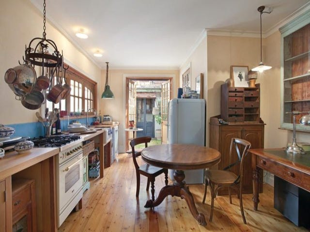 A quirky kitchen with lots of character and all the woods working well together. Just enough clutter to the look.
