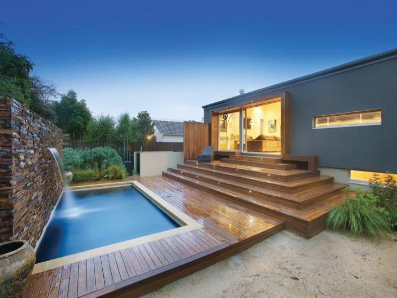 In Ground Pool Design Using Natural Stone With Decking