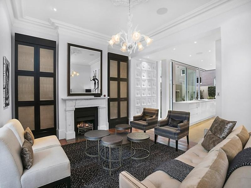 Ceiling cornices and ceiling rose, wooden floors and fireplace retained at 49 East Crescent Street, McMahons Point