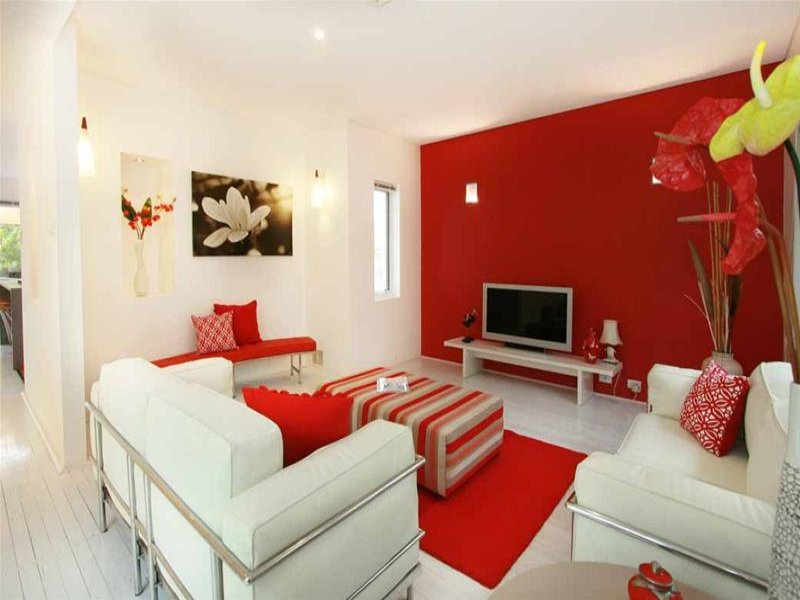 Red living room idea from a real australian home living area photo 525685 for Red and white living room ideas