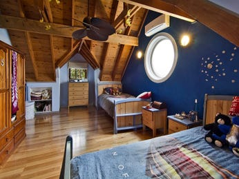 Country bedroom design idea with floorboards & exposed eaves using blue colours - Bedroom photo 2224441