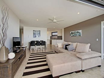 Open plan living room using grey colours with tiles & ceiling skylight - Living Area photo 104080