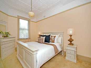 Classic bedroom design idea with carpet & louvre windows using beige colours - Bedroom photo 369174