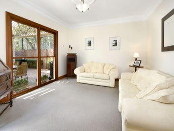 Open plan living room using cream colours with leather & french doors - Living Area photo 105227