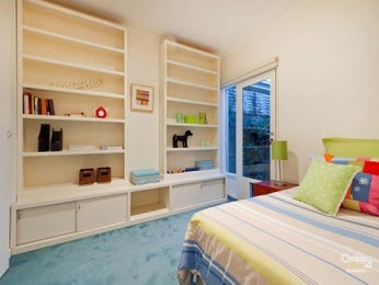 Children's room bedroom design idea with carpet & built-in shelving using blue colours - Bedroom photo 105475