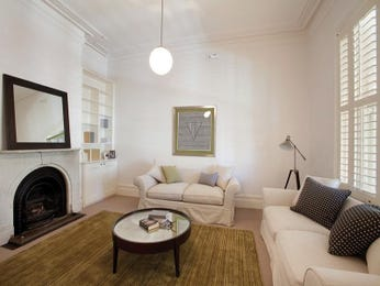 Open plan living room using cream colours with carpet & ceiling rose - Living Area photo 105946
