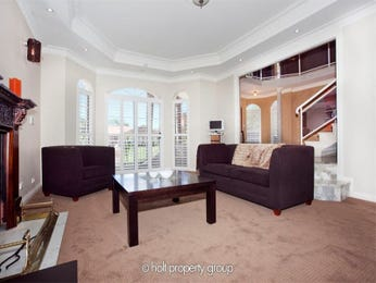 Brown living room idea from a real Australian home - Living Area photo 351193
