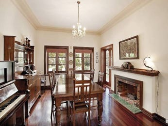 Classic dining room idea with hardwood & fireplace - Dining Room Photo 472194