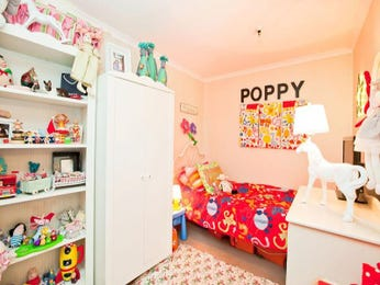 Children's room bedroom design idea with carpet & built-in shelving using orange colours - Bedroom photo 106346