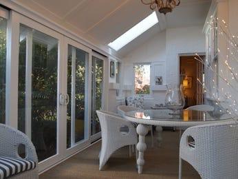 Retro dining room idea with carpet & bi-fold doors - Dining Room Photo 107181