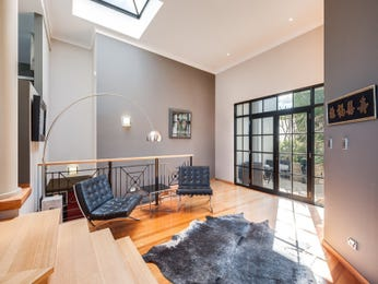 Split-level living room using grey colours with floorboards & floor-to-ceiling windows - Living Area photo 16042401