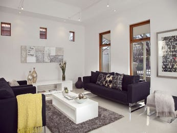 Open plan living room using neutral colours with carpet & floor-to-ceiling windows - Living Area photo 107578