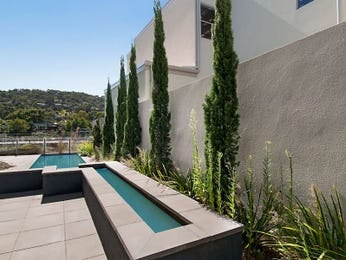 Landscaped pool design using tiles with cabana & fountain - Pool photo 107704