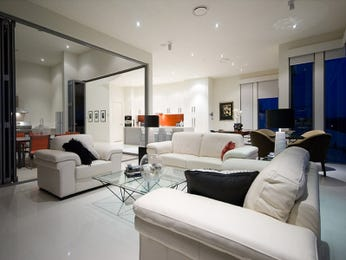 Open plan living room using white colours with carpet & bay windows - Living Area photo 107799