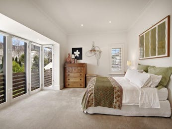 Classic bedroom design idea with carpet & bi-fold windows using brown colours - Bedroom photo 108292