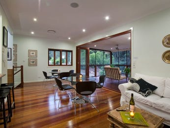 Open plan living room using black colours with floorboards & floor-to-ceiling windows - Living Area photo 8320381