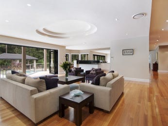 Open plan living room using white colours with hardwood & exposed eaves - Living Area photo 108812