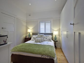 Modern bedroom design idea with wood panelling & bi-fold windows using white colours - Bedroom photo 109672