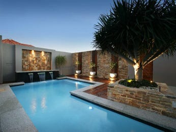Geometric pool design using brick with gazebo & decorative lighting - Pool photo 109727