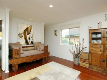 Open plan living room using beige colours with carpet & bay windows - Living Area photo 109840