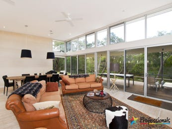 Open plan living room using orange colours with leather & floor-to-ceiling windows - Living Area photo 8833761
