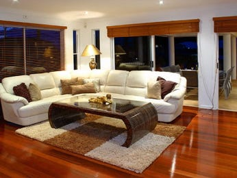 Open plan living room using brown colours with carpet & floor-to-ceiling windows - Living Area photo 364600