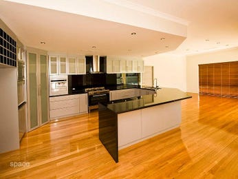 Modern u-shaped kitchen design using floorboards - Kitchen Photo 520130