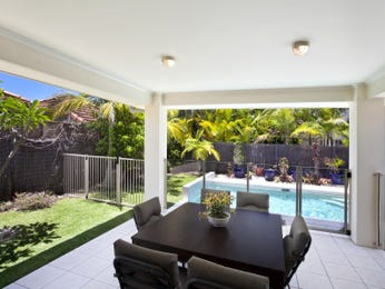 Enclosed outdoor living design with glass balustrade & outdoor furniture setting using tiles - Outdoor Living Photo 864612