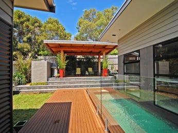 In-ground pool design using grass with bbq area & outdoor furniture setting - Pool photo 113560