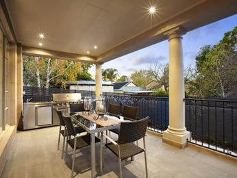 Indoor-outdoor outdoor living design with balcony & decorative lighting using tiles - Outdoor Living Photo 113792