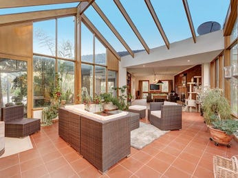 Enclosed outdoor living design with outdoor dining & outdoor furniture setting using tiles - Outdoor Living Photo 8940117