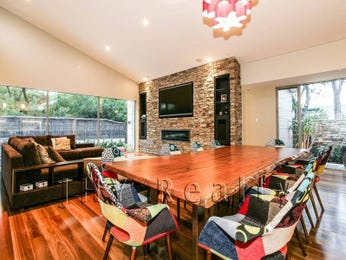 Classic dining room idea with exposed brick & fireplace - Dining Room Photo 7045557