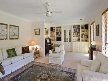 Open plan living room using white colours with carpet & bay windows - Living Area photo 115800