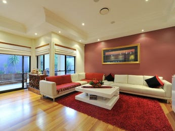 Open plan living room using pink colours with floorboards & floor-to-ceiling windows - Living Area photo 644392