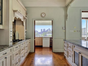 Country galley kitchen design using floorboards - Kitchen Photo 117952