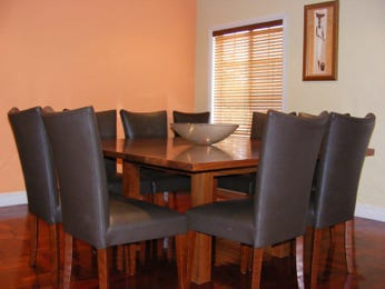 Classic dining room idea with floorboards & louvre windows - Dining Room Photo 438132