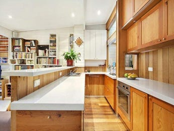 Country galley kitchen design using floorboards - Kitchen Photo 697725