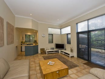 Split-level living room using black colours with carpet & bay windows - Living Area photo 439713