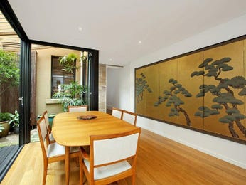 Modern dining room idea with floorboards & floor-to-ceiling windows - Dining Room Photo 466165