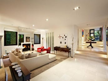 Open plan living room using beige colours with carpet & fireplace - Living Area photo 167700