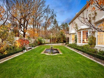 Landscaped garden design using grass with deck & fountain - Gardens photo 168919