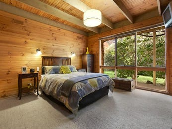 Classic bedroom design idea with hardwood & exposed eaves using brown colours - Bedroom photo 2248221
