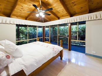 Classic bedroom design idea with hardwood & exposed eaves using white colours - Bedroom photo 7180461