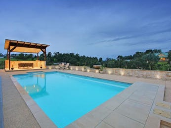 In-ground pool design using stone with pergola & ground lighting - Pool photo 171288